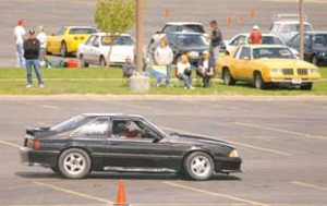 LARRY MAYER/Gazette Staff A driver races through a pylon course in the Skyview High parking lot during the Memorial Day w eekend autocross event. The Yellow stone Region Sports Car Club of America holds local events to hone drivers' carhandling skills.